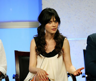 Zooey Deschanel on a talkshow with plats, pig tails