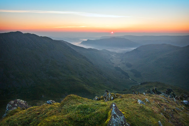 Wild Camping at hard tarn, lake district. Sunrise from Nethermost Pike looking east to Patterdale, Ullswater and the Pennines.