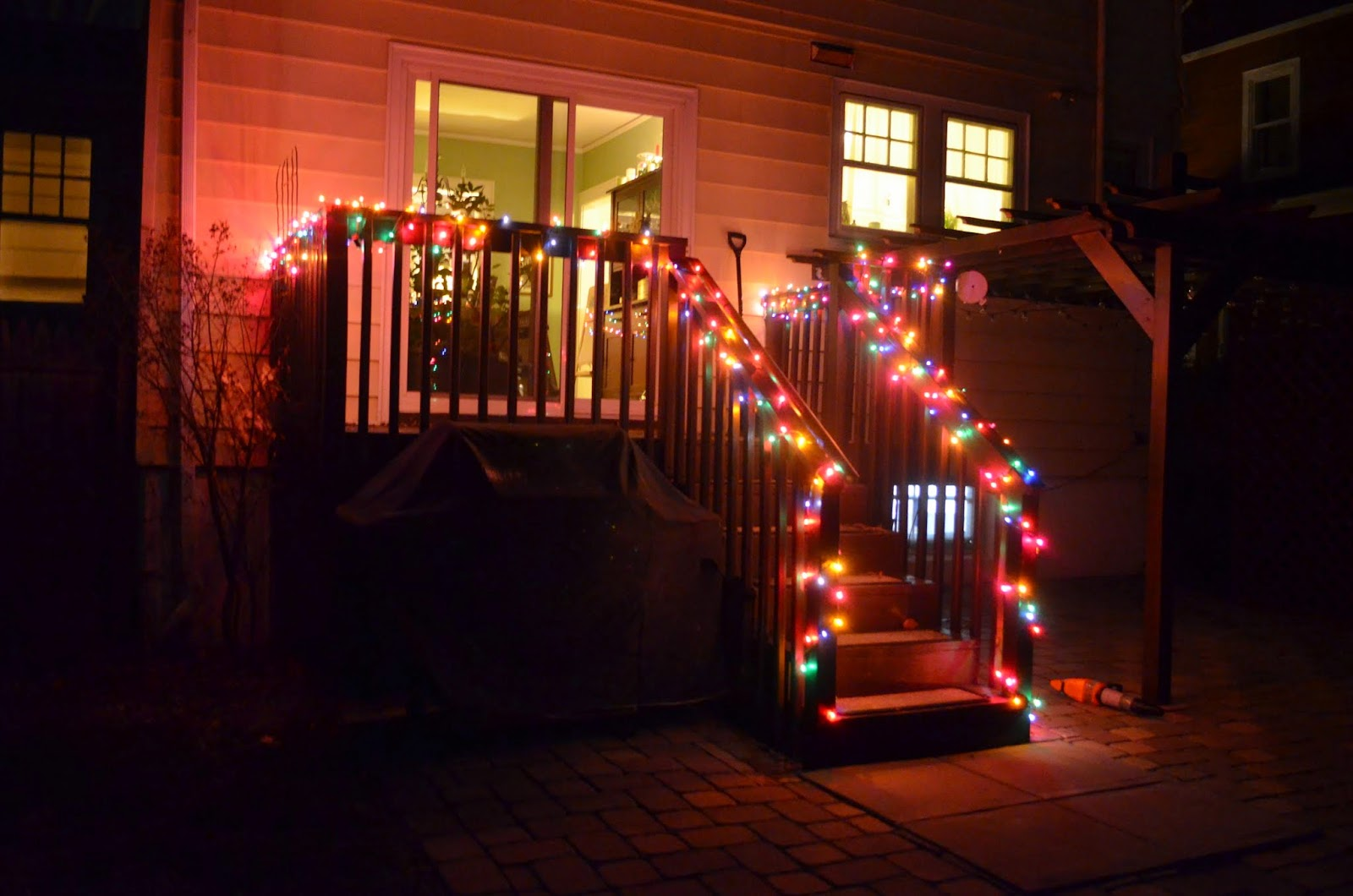 In the little yellow house outdoor christmas lights at night in the backyard weve added color strands along the deck railing its so pretty when we look out the back window i love it mozeypictures Gallery