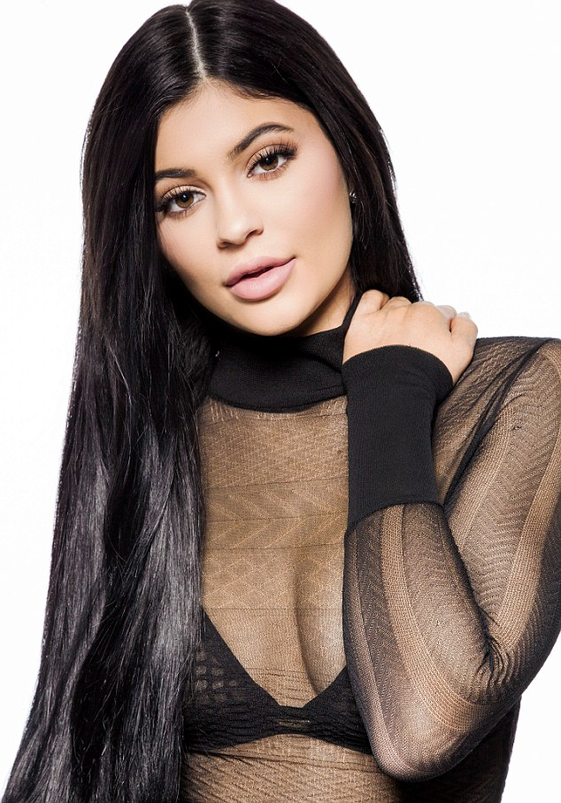 Kylie Jenner looks sensational as she reveals her black bra in a sheer top to celebrate her latest beauty campaign 2
