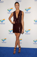 Stacy Keibler on the blue carpet in a mini skirt