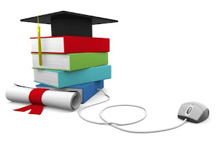 stacked books with graduation cap on top with computer mouse connected to the stack