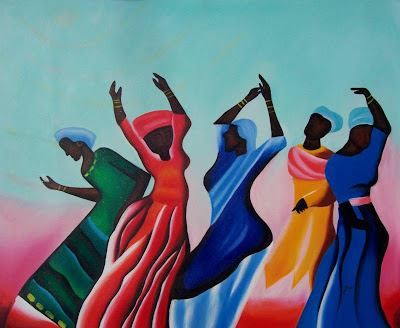 five African American women, in brightly colored dresses, dancing with their hands in the air