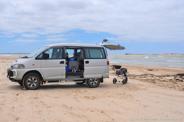 Four wheel drive van at the beach