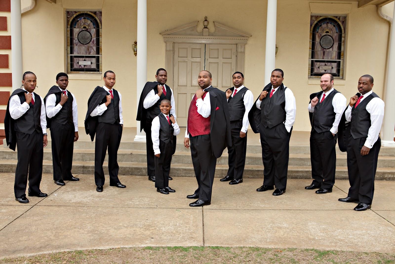 Groomsmen with groom outside church