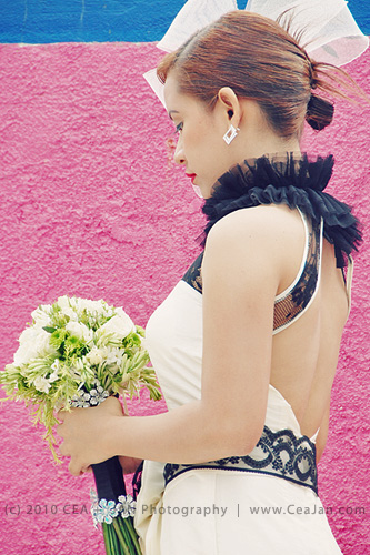 Chic mermaid style wedding dress with black lace detail designed by Doddie