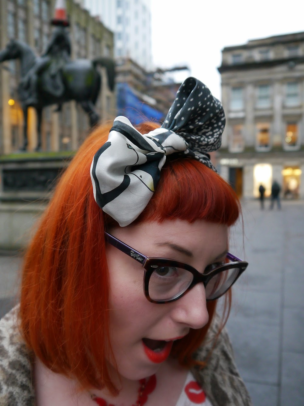 Karen Mabon Penguin Scarf, Hair Bow. Scottish Blogger, Glasgow, cat eye glasses, ginger hair, hair accessory, Monki lip print top, leopard print coat warehouse, black skinny jeans, red shoes, Lou Taylor Match Brooch, Tatty Devine Lobster Necklace