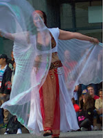 Woman performing exotic belly-dance