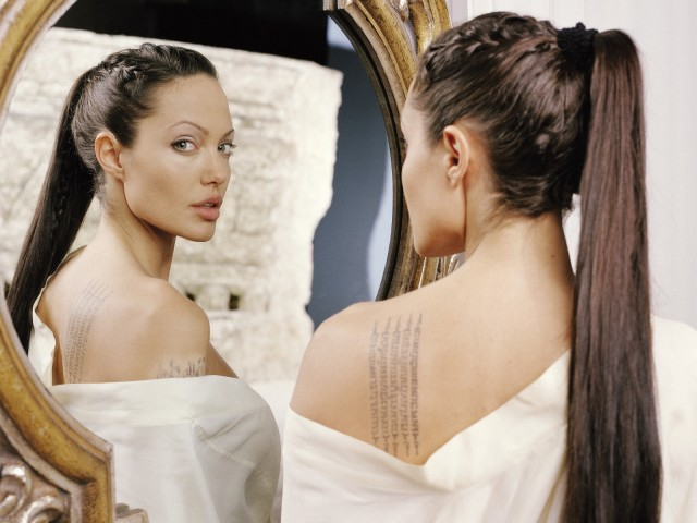 angelina jolie tattoos on back. Angelina Jolie Tattoos Wanted
