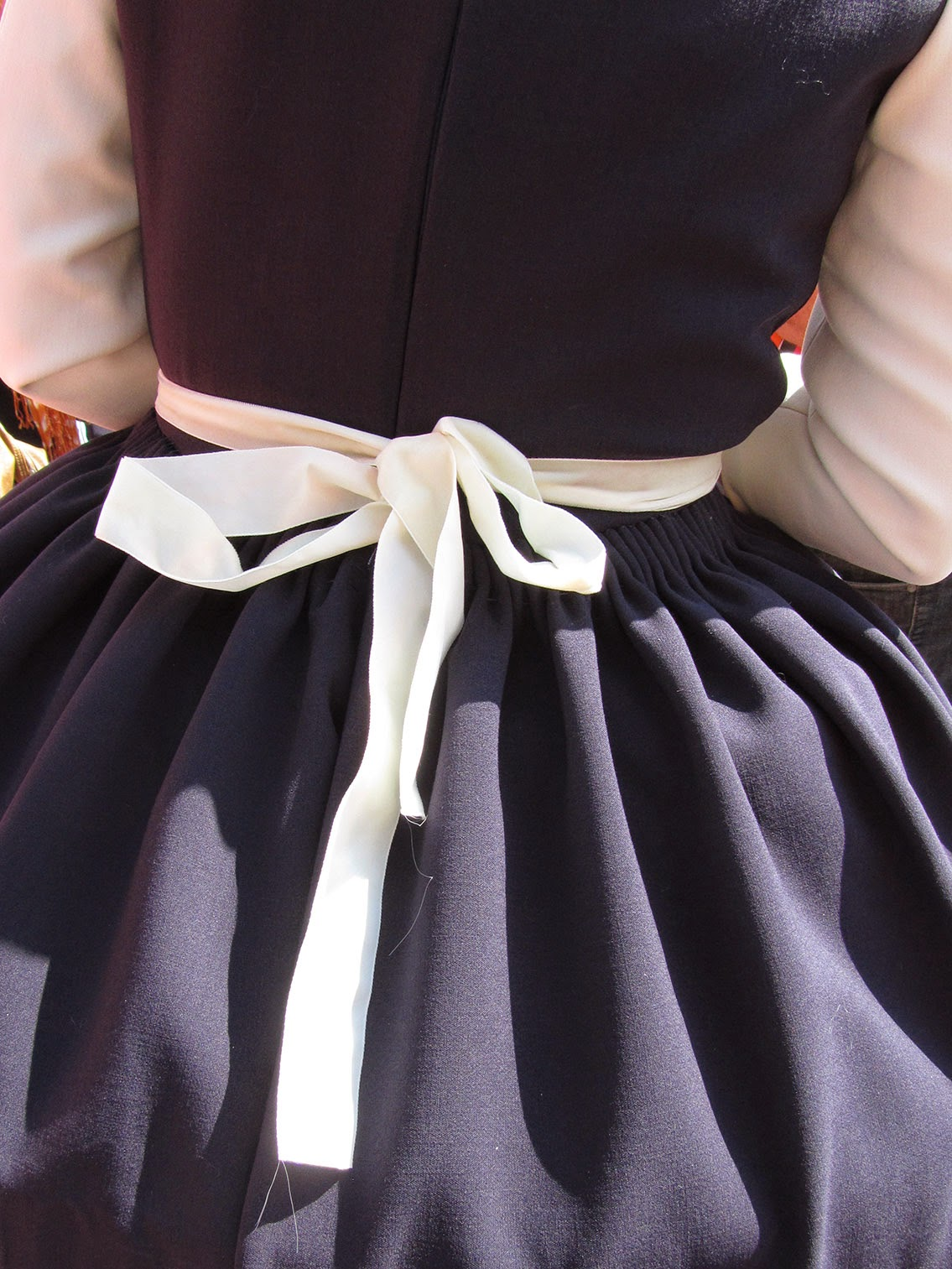 white bow and cartridge pleating