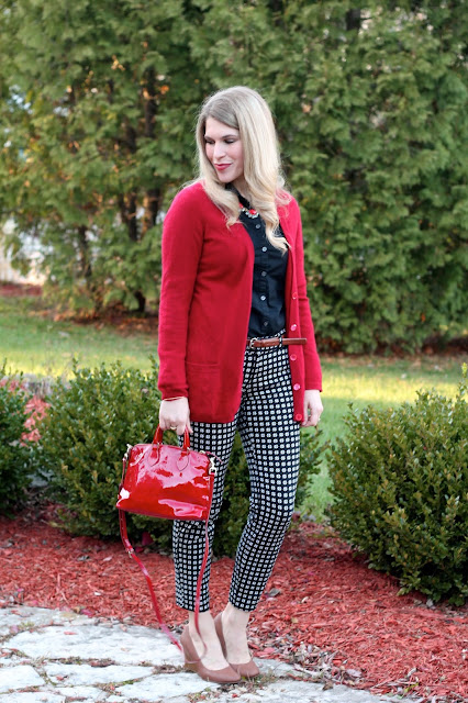 great work outfit with pixie pants, black button up, and red cardigan