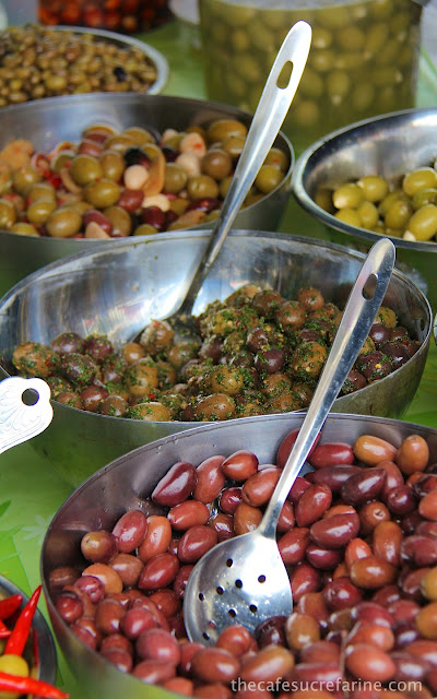 Large bowls of olives in every size, shape and color.
