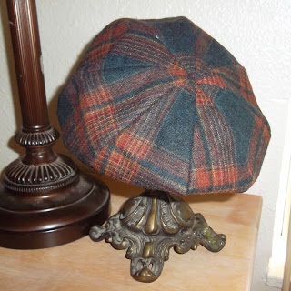Eight-paneled crown for 'newsboy' style hat in blue and burgundy plaid