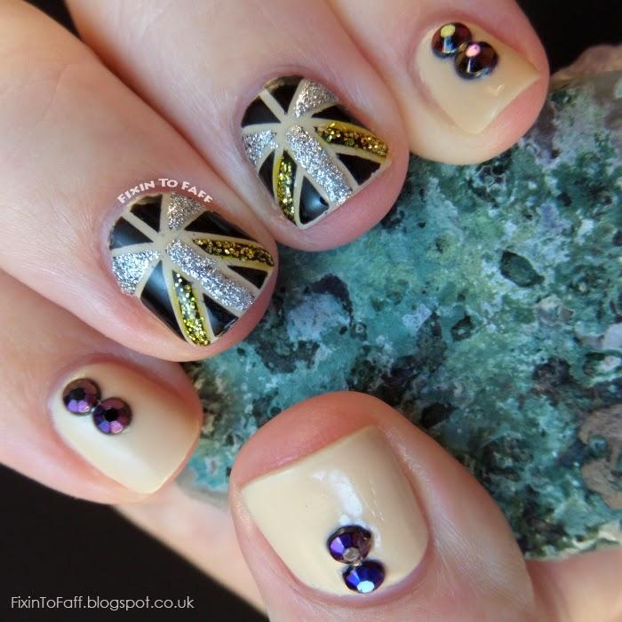 Art Deco inspired nail art using striping tape, glitter, and rhinestones.