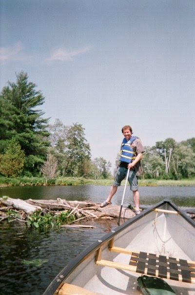 attempting a portage over a beaver damn