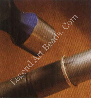Fuse the joint together on both rings, place them on a mandrel, and then hammer them until they are round.