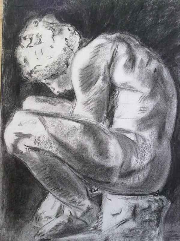dibujo a carboncillo de niño agachado