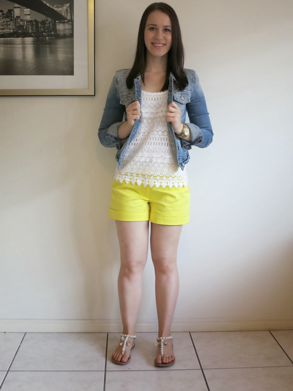 uni outfit, college outfit, petite girl outfit, yellow shorts, cream embellished tank, cream sandals, denim jacket, gold michael kors watch