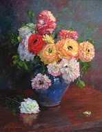Colorful Ranunculus in Blue Vase