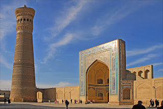 The Kalan Minaret, also known as the Tower of Death, looms over hte square in front of the Mir-I Arab Madrassa.
