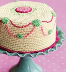 http://translate.google.es/translate?hl=es&sl=en&tl=es&u=http%3A%2F%2Fwww.favecrafts.com%2FKitchen-Crochet%2FCrochet-Cake-Pattern