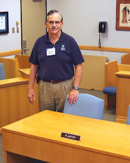 SHSU Alumnus Dr. James Benson built a courtroom in a classroom at the University of Houston - Clear Lake.