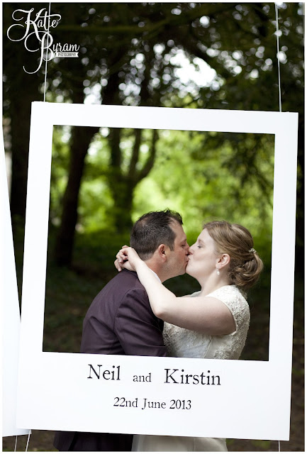 polaroid frame, bride and groom kiss, quirky wedding photography, ellingham hall, ellingham hall wedding, northumberland wedding photographer, newcastle wedding photographer, ceremony signs, paper pom poms, quirky wedding photography, katie byram photography, diy wedding