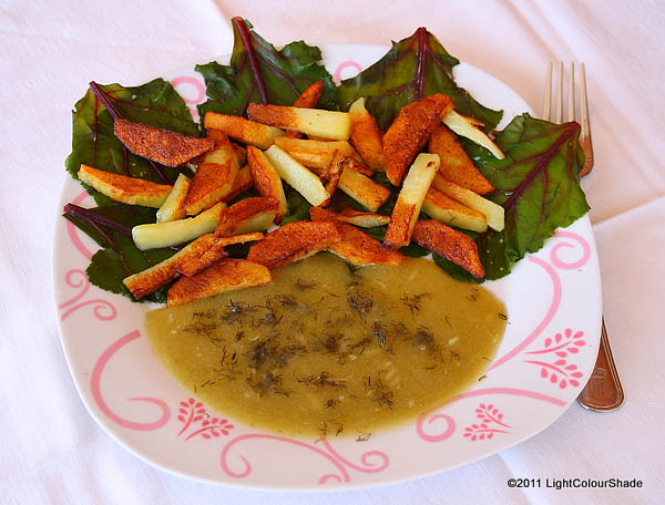 Steamed beetroot leaves and fried potatoes with sour plum sauce