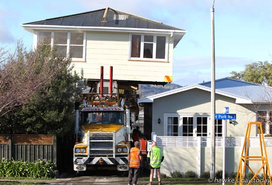 Brittons Housemovers Ltd Hawke's Bay (no apostophe in Brittons), lifted this 20-tonne house 6.0m to clear neighbouring houses as it was shifted onto a back-section sub-division in Park Rd North, Hastings. Staff from Brittons Wellington also helped. Two houses came from Waiouru Army Camp. photograph