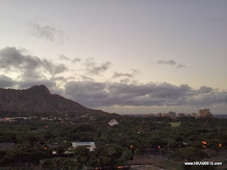 This photo shows the view of the sun rising behind Diamond Head