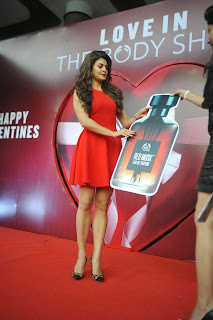 Actress Jacqueline Fernandez  Pictures in Red Short Dress at The Body Shop Launch  10.JPG