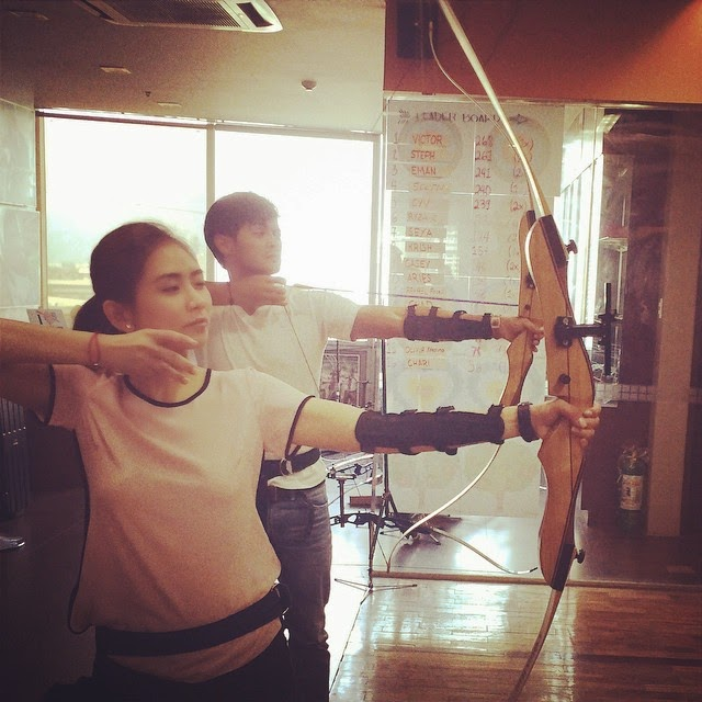 Sarah Geronimo and Matteo Giudicelli having fun with archery
