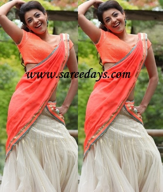 Latest saree designs kajal agarwal in peach and off white half saree checkout indian actress kajal agarwal in peach and off white half saree with peach pallu with gold and silver shimmer border and netted off white lehenga altavistaventures Image collections
