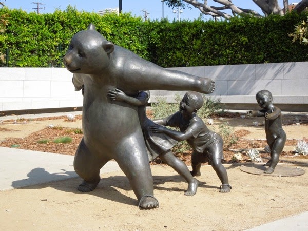 The Game bear and children sculpture West Hollywood Park
