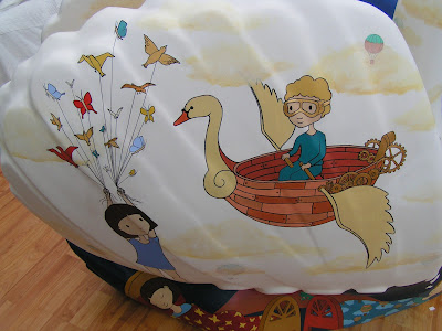 close up of a boy rowing a flying swan boat on the willowandme.co.uk swan of wells