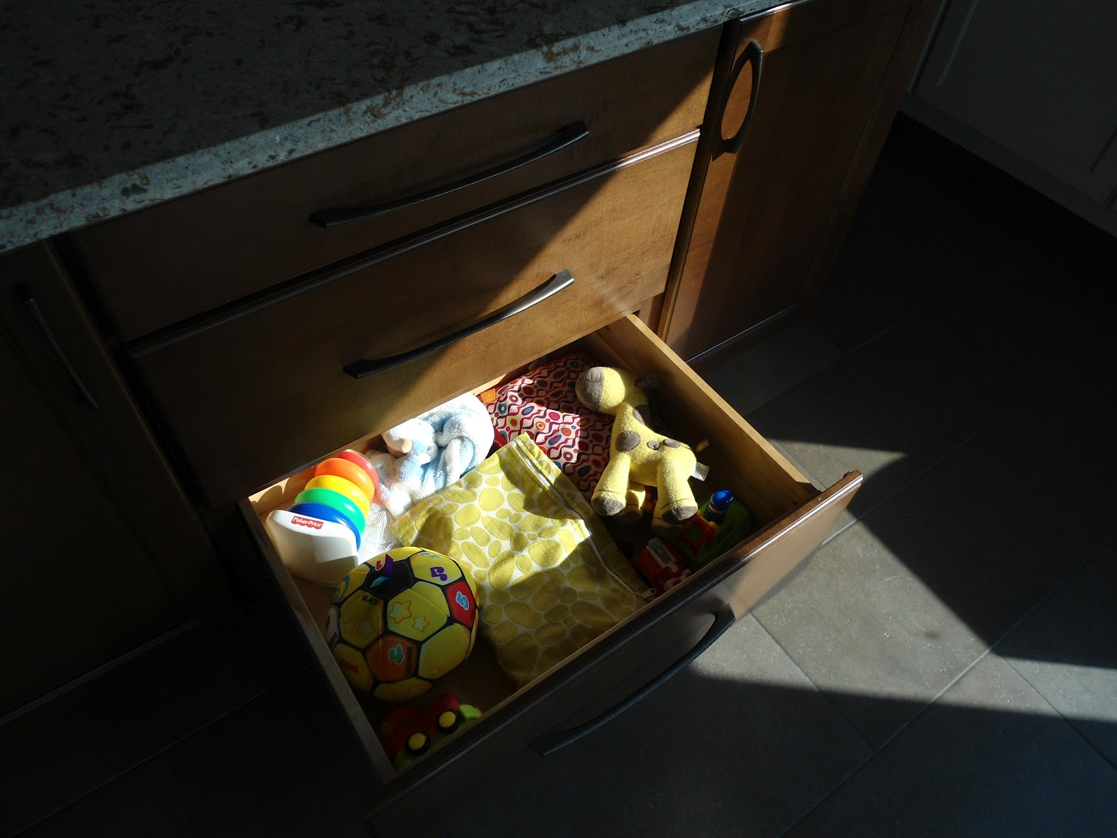 Bottom drawer of the island is toy storage. Our kids love to pull the