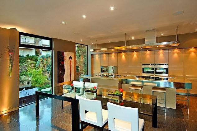 Dise o de una moderna casa de piedra con hormig n en la - Cocinas comedor modernas ...
