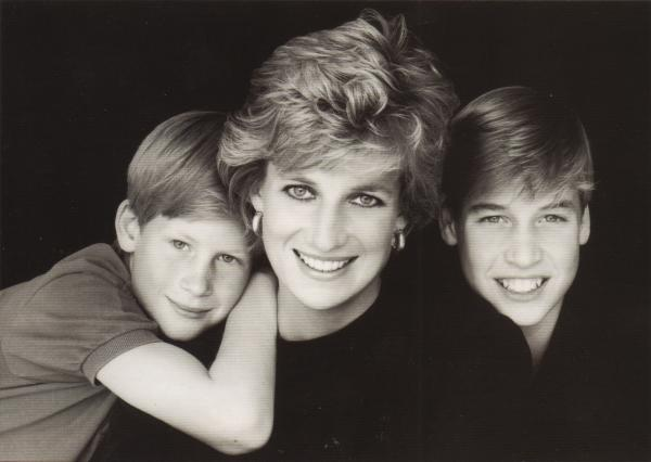 black and white card of Diana with princes William and Harry
