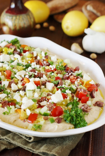 Loaded Hummus Dip ~ Entertain with ease with a platter of this delicious dip ... easy & always a hit!  Perfect for game day or ANY party.   www.thekitchenismyplayground.com