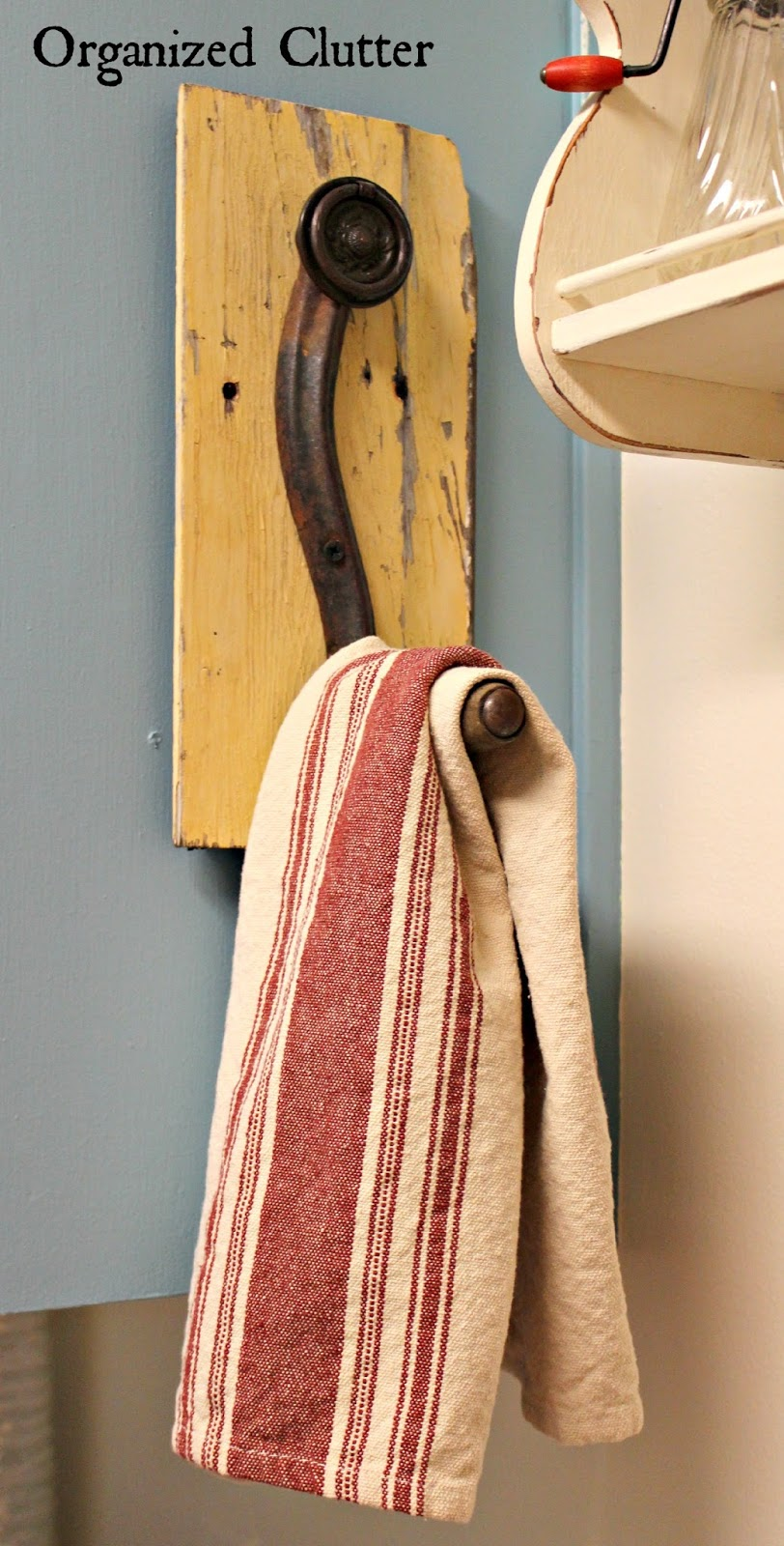 Repurposed Crank Handle Towel Hook www.organizedclutterqueen.blogspot.com