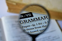 grammar book with magnifying glass