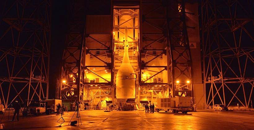 Engineers and technicians at Space Launch Complex 37 move Orion into place in the service structure so the spacecraft can be lifted and joined to the top of the Delta IV Heavy rocket. Photo credit: NASA/Radislav Sinyak