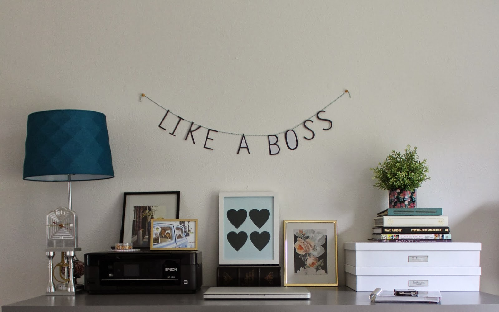home office with like a boss banner
