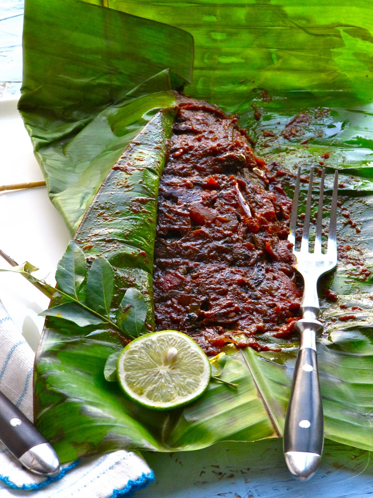 Plateful Karimeen pollichathu — Pearlspot fish grilled in banana leaf