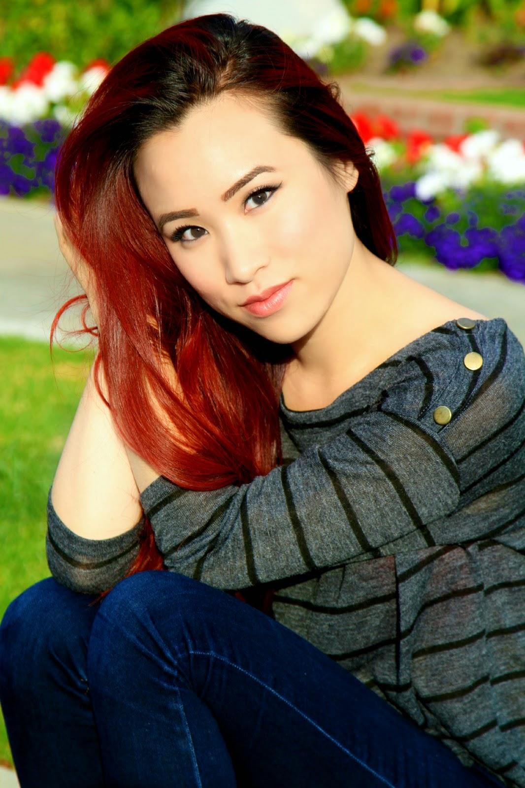 red hair girl wearing false lashes