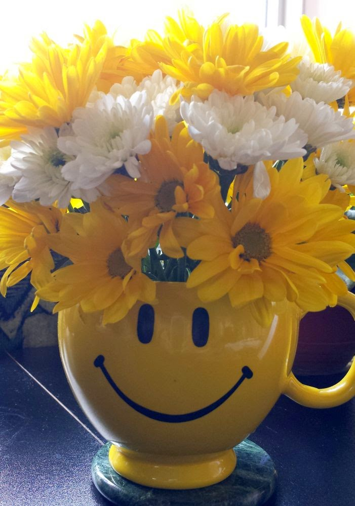 Week 18: In your (their) hands ~ home made cheerful flower arrangement, smiley mug :: All Pretty Things