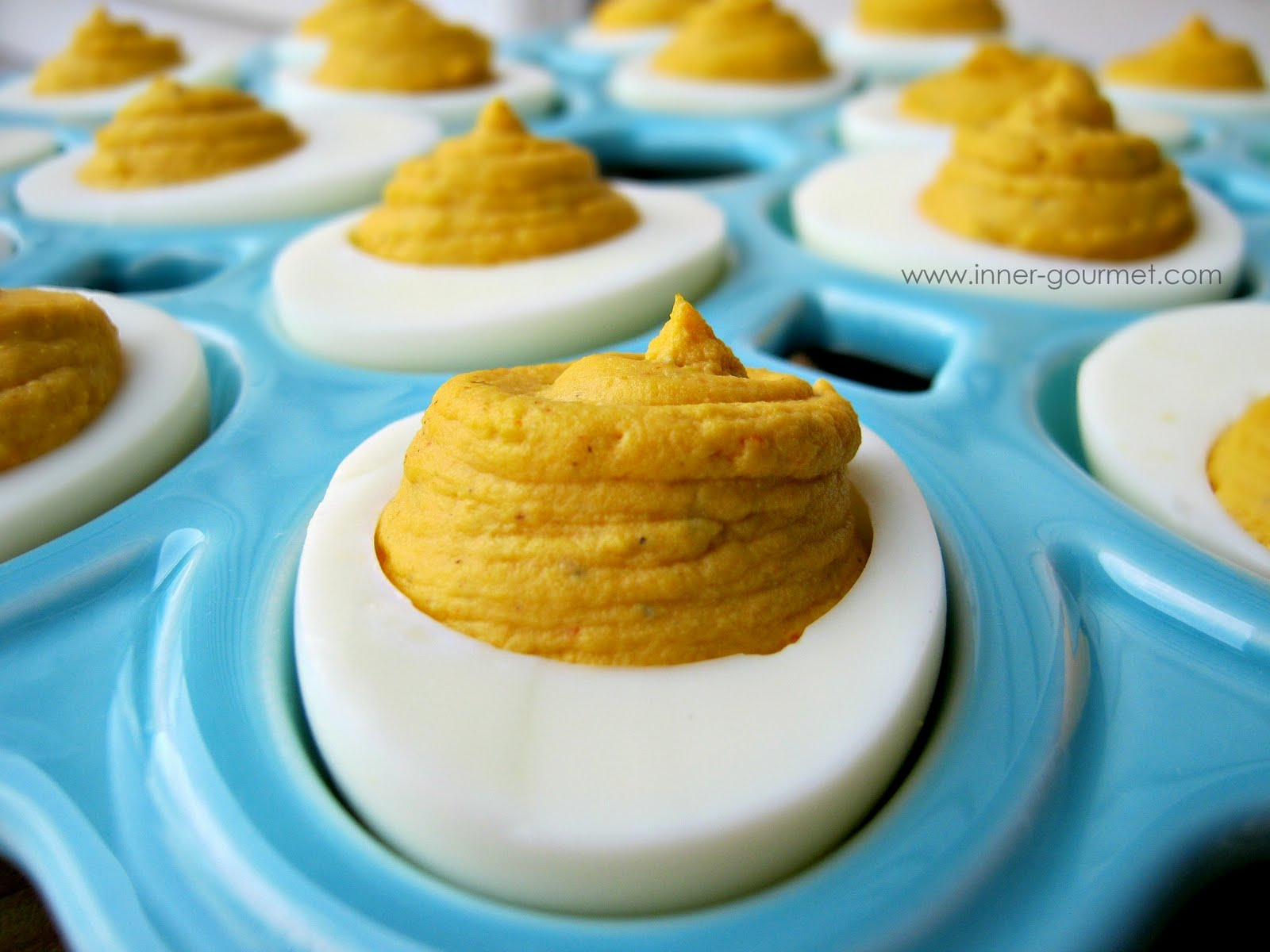 Drop a dot of sriracha on each egg. If making these ahead of time ...