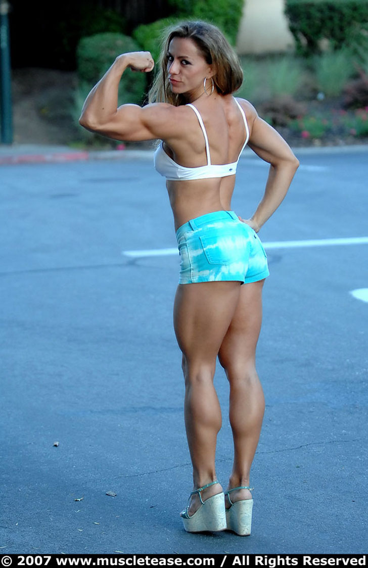 Juliana Malacarne Flexing Her Bicep And Great Calves