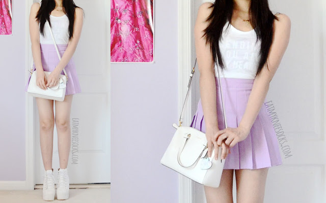 A cute pastel-grunge outfit, with a custom-print Snapmade tank, American Apparel lilac pleated tennis skirt dupe, heart keychain, spiked white booties, and a Coach white purse.