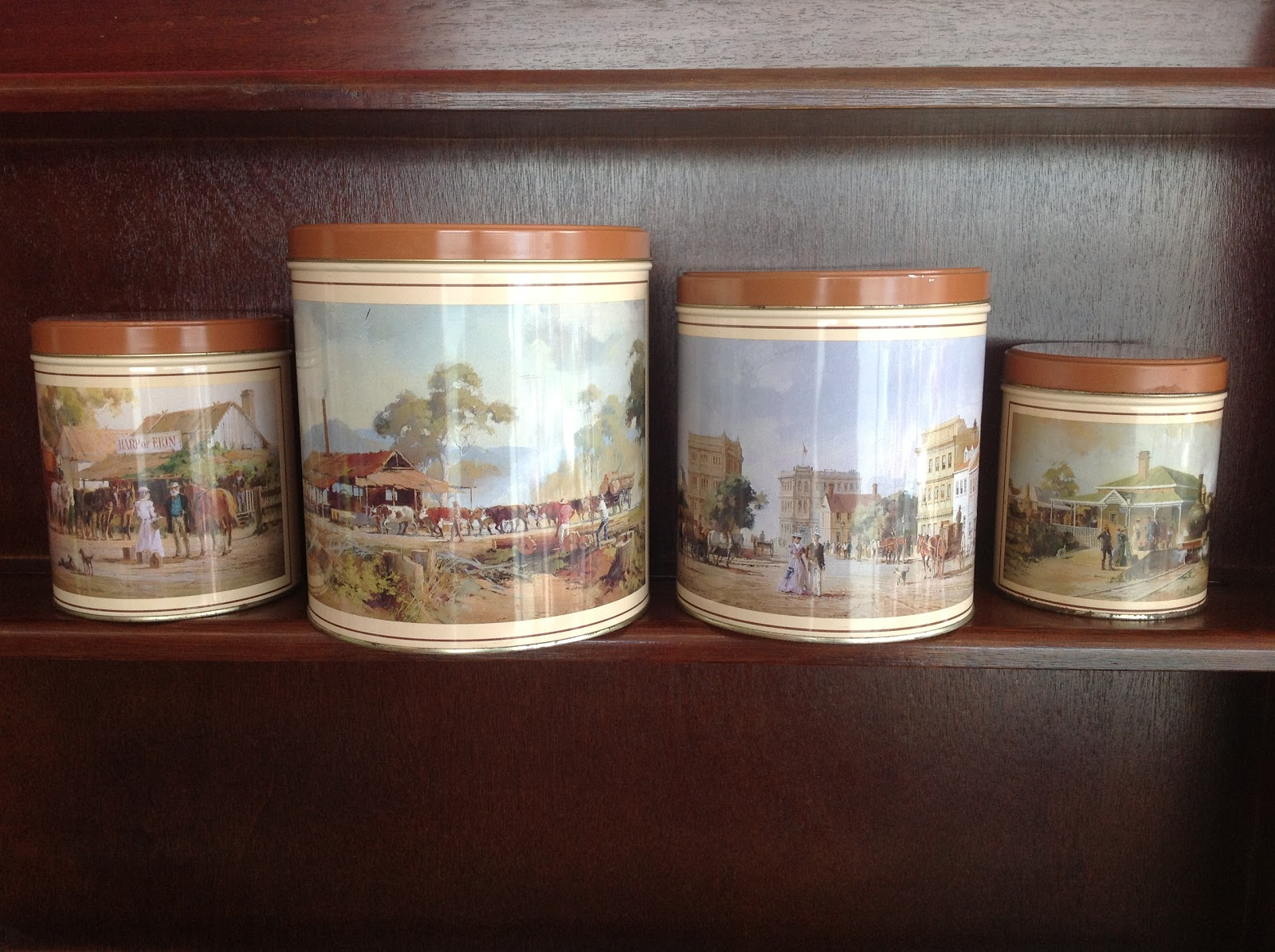 4 collectable tin canisters with Australian scenes